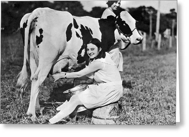 Young Woman Milking A Cow Greeting Card by Underwood Archives