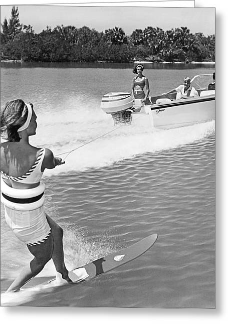 Slalom Skiing Greeting Cards - Young Woman Slalom Water Skis Greeting Card by Underwood Archives