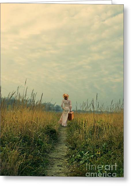 Young Teen Greeting Cards - Young Woman Walking With a Suitcase on Country Path Greeting Card by Jill Battaglia