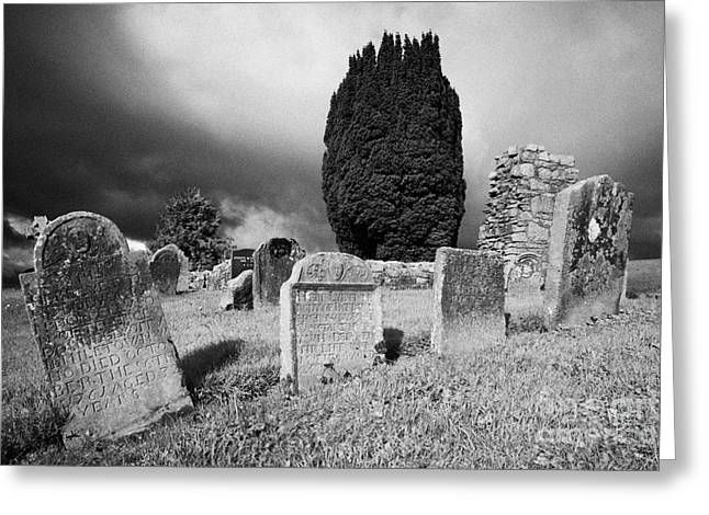 Headstones Greeting Cards - 18th century irish gravestones next to the ruins of St Kierans errigal keerogue church county tyrone Greeting Card by Joe Fox