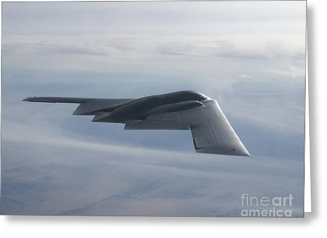 Military Airplanes Greeting Cards - A B-2 Spirit Soars Through The Sky Greeting Card by Stocktrek Images