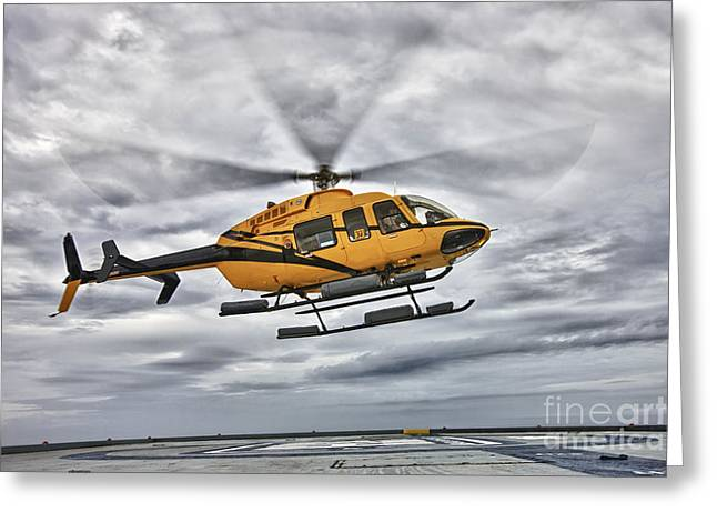 Rotorcraft Greeting Cards - A Bell 407 Utility Helicopter Prepares Greeting Card by Terry Moore