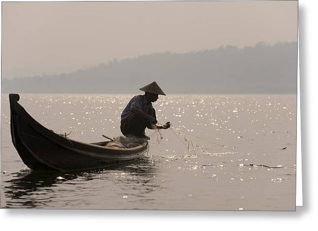 Reaping Greeting Cards - A Fisherman Pulls In His Net Greeting Card by Alex Treadway