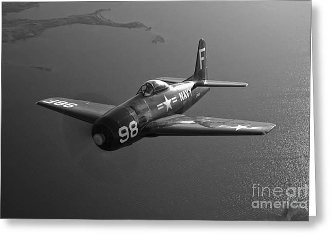 Military Plane Greeting Cards - A Grumman F8f Bearcat In Flight Greeting Card by Scott Germain