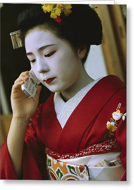 A Kimono-clad Geisha Talks On A Cell Greeting Card by Justin Guariglia