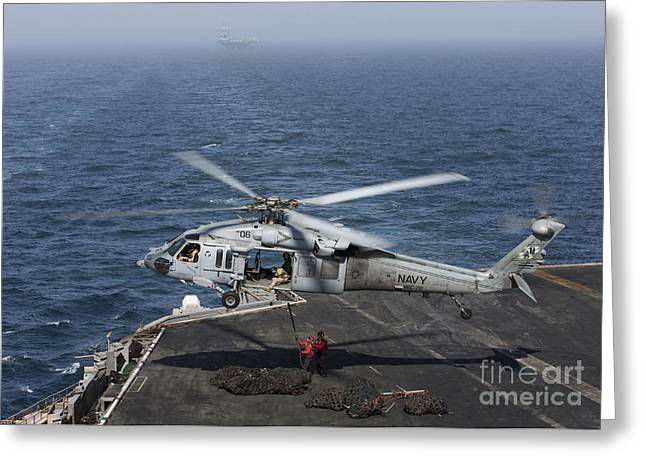 Arabian Sea Greeting Cards - A Mh-60s Knighthawk Conducts A Vertical Greeting Card by Gert Kromhout