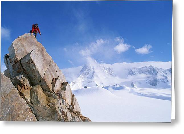 Tyree Greeting Cards - A Mountain Climber Summits Mount Greeting Card by Gordon Wiltsie