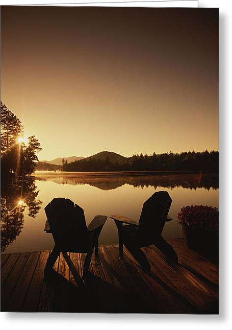Model Release Greeting Cards - A Pair Of Adirondack Chairs On A Dock Greeting Card by Michael Melford