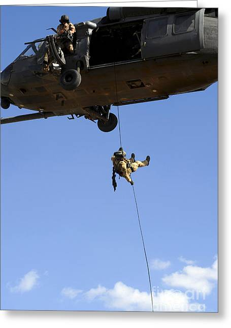 Baghdad Greeting Cards - A Pararescueman Rappels From An Hh-60 Greeting Card by Stocktrek Images