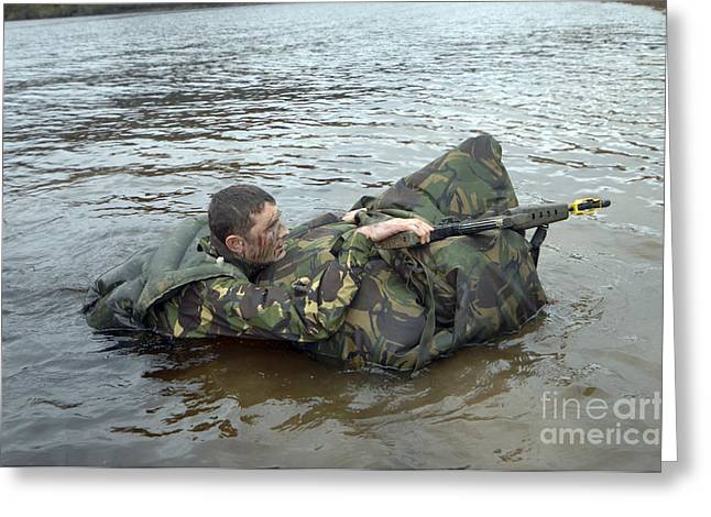 Physical Exhaustion Greeting Cards - A Soldier Participates In A River Greeting Card by Andrew Chittock