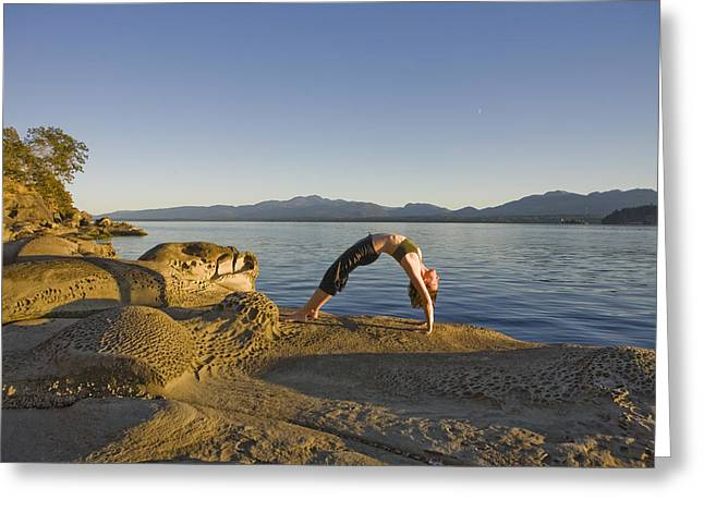 A Woman Does Yoga At Sunset Greeting Card by Taylor S. Kennedy