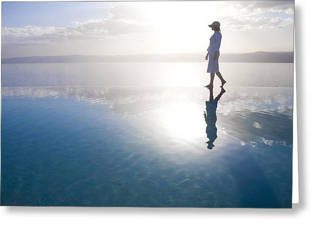 Jordan Greeting Cards - A Woman Enjoys The Warm Sun On The Edge Greeting Card by Taylor S. Kennedy