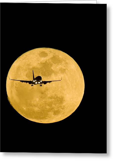 Passenger Planes Greeting Cards - Aeroplane Silhouetted Against A Full Moon Greeting Card by David Nunuk