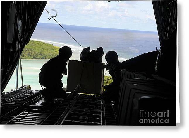 Yap Greeting Cards - Airmen Push Out A Pallet Of Donated Greeting Card by Stocktrek Images