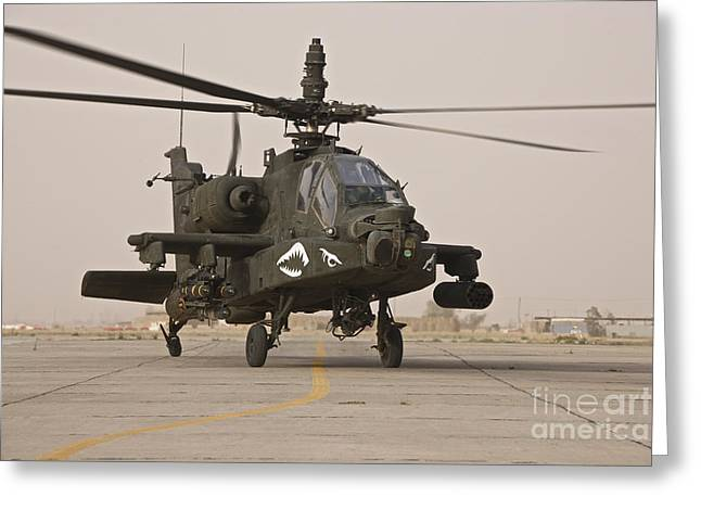 Iraq War Greeting Cards - An Ah-64 Apache Helicopter Taxiing Greeting Card by Terry Moore