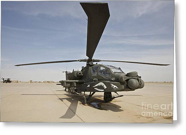 Ah-64 Greeting Cards - An Ah-64d Apache Helicopter At Cob Greeting Card by Terry Moore