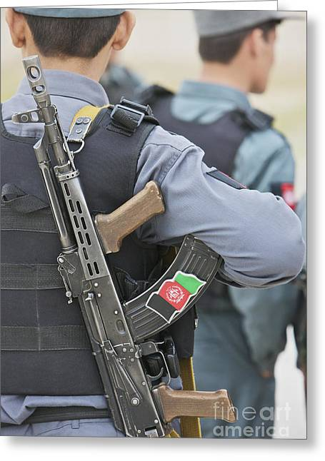 Afghanistan National Police Greeting Cards - An Ak-47 Rests On The Sling Of An Greeting Card by Terry Moore