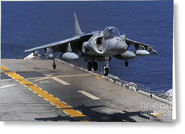East China Greeting Cards - An Av-8b Harrier Jet Lands Greeting Card by Stocktrek Images