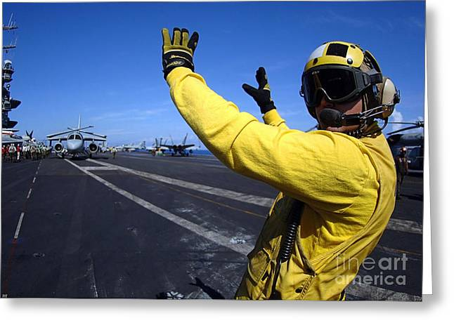 Transceiver Greeting Cards - An Aviation Boatswains Mate Directs Greeting Card by Stocktrek Images