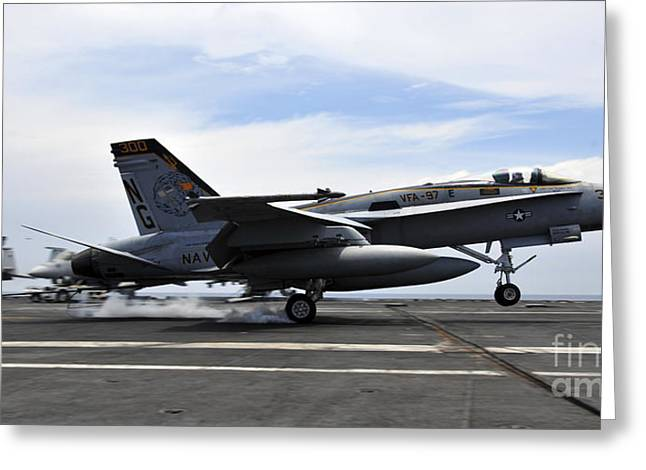Flight Deck Greeting Cards - An Fa-18c Hornet Lands Aboard Greeting Card by Stocktrek Images