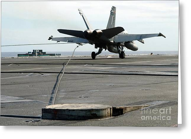 Enterprise Greeting Cards - An Fa-18c Hornet Makes An Arrested Greeting Card by Stocktrek Images