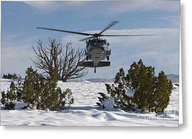 Snow Covered Ground Greeting Cards - An Hh-60g Pave Hawk Flys Low Greeting Card by HIGH-G Productions