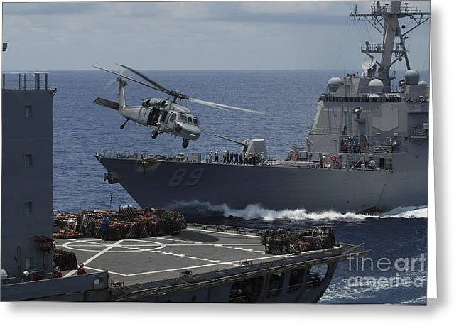 Uss Essex Greeting Cards - An Mh-60s Knighthawk Helicopter Greeting Card by Stocktrek Images