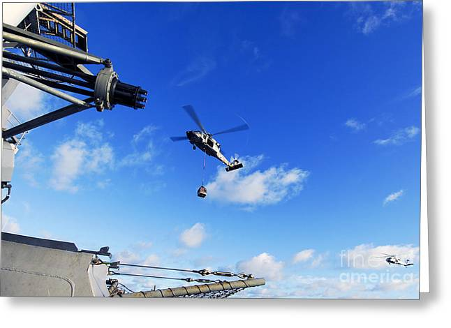 Underway Greeting Cards - An Mh-60s Sea Hawk Helicopter Greeting Card by Stocktrek Images