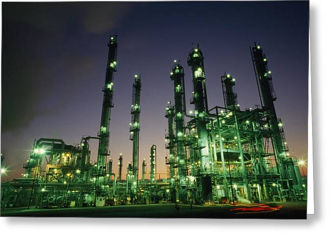 Refineries Greeting Cards - An Oil Refinery At Dusk Greeting Card by Lynn Johnson