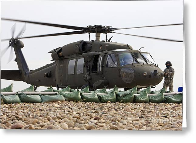 Iraq Greeting Cards - Balad, Iraq - A Uh-60l Black Hawk Lands Greeting Card by Terry Moore