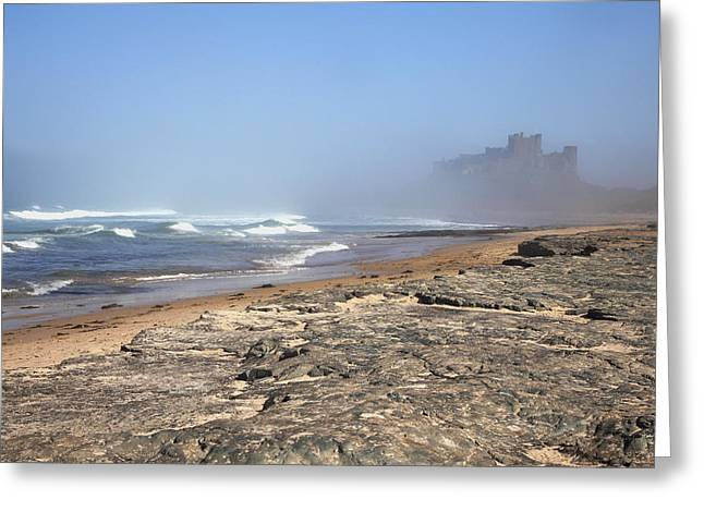 Foggy Day Greeting Cards - Bamburgh Castle In The Fog Bamburgh Greeting Card by John Short