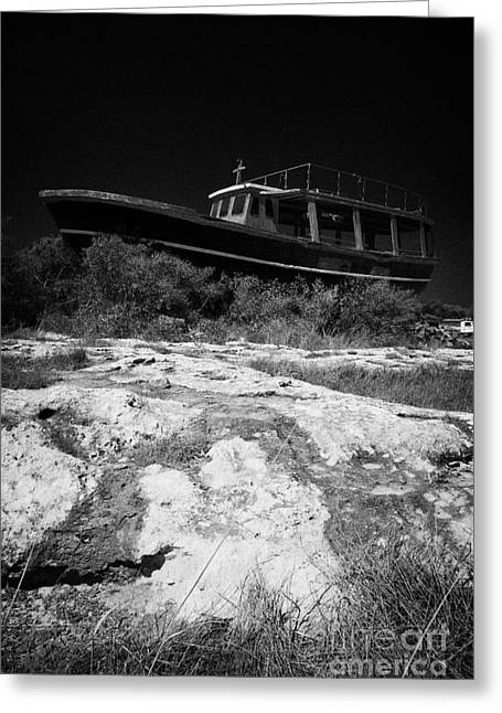 Fishing Creek Greeting Cards - Beached Abandoned Fishing Boat In Potamos Typical Small Unspoilt Fishing Village Republic Of Cyprus  Greeting Card by Joe Fox