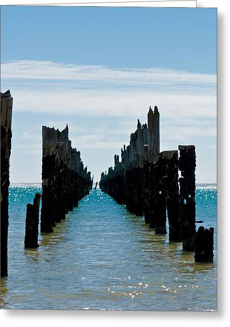 Island .oasis Greeting Cards - Beautiful rotten mooring on a beach where only the pillars are l Greeting Card by Ulrich Schade