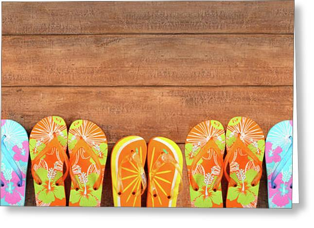 Weekend Photographs Greeting Cards - Brightly colored flip-flops on wood  Greeting Card by Sandra Cunningham