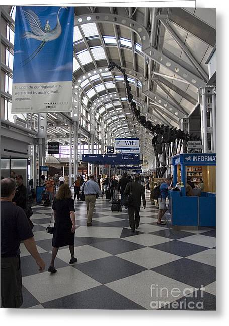 Rolling Luggage Greeting Cards - Busy airport terminal concourse at Chicagos OHare airport Greeting Card by Christopher Purcell