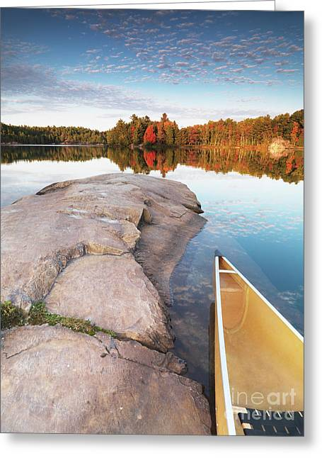 Canoe Greeting Cards - Canoe at a Rocky Shore Autumn Nature Scenery Greeting Card by Oleksiy Maksymenko
