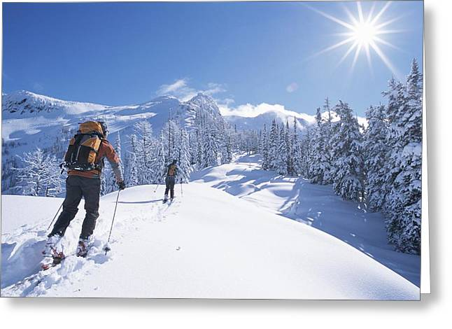 Cross-country Skiers In The Selkirk Greeting Card by Jimmy Chin
