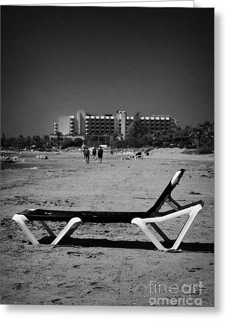Kypros Greeting Cards - Empty Sun Lounger On Cyprus Tourist Organisation Municipal Beach In Larnaca Bay Republic Of Cyprus Greeting Card by Joe Fox