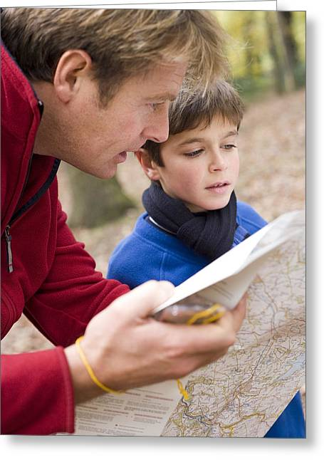 Physical Skill Greeting Cards - Father And Son Reading A Map Greeting Card by Ian Boddy