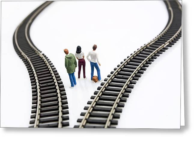 Pensively Greeting Cards - Figurines between two tracks leading into different directions symbolic image for making decisions. Greeting Card by Bernard Jaubert