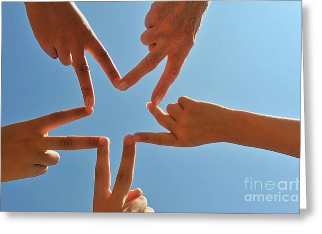 8-9 Years Greeting Cards - Five hands drawing a star shape Greeting Card by Sami Sarkis
