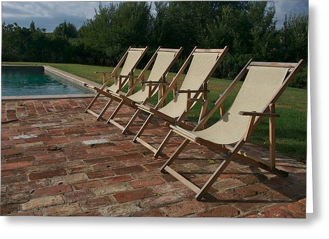 Brick Patio Greeting Cards - Four Deck Chairs Await Visitors Greeting Card by Heather Perry