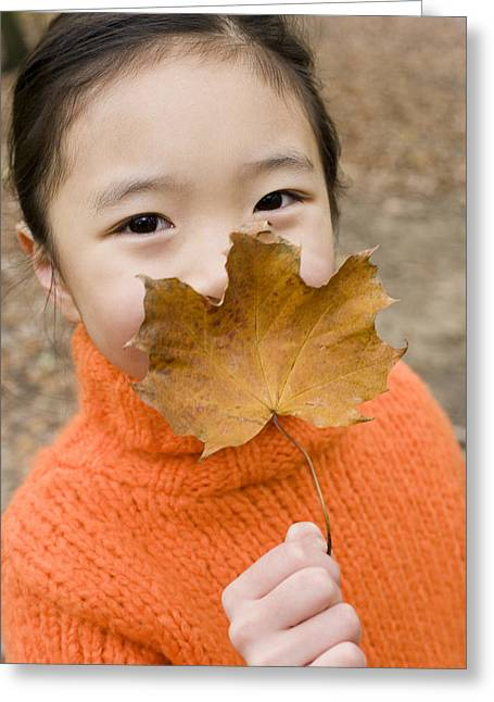 Child Care Greeting Cards - Girl Holding An Autumn Leaf Greeting Card by Ian Boddy