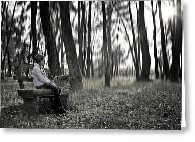 Girl sitting on a wooden bench in the forest against the light Greeting Card by Joana Kruse