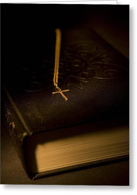 Gold Necklace Greeting Cards - Gold Cross Pendant Resting On A Book Greeting Card by Philippe Widling