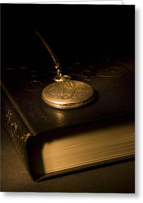 Watch Fob Greeting Cards - Gold Pocket Watch Resting On A Book Greeting Card by Philippe Widling
