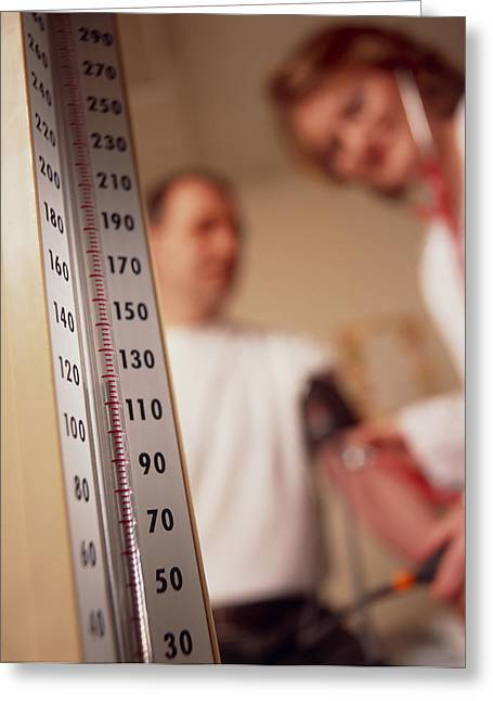 Blood Pressure Greeting Cards - Gp Doctor Taking Blood Pressure Of Male Patient Greeting Card by Tek Image