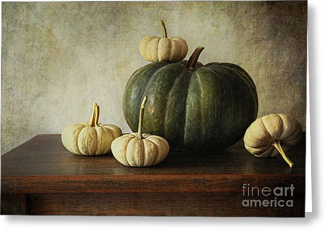 Gourd Greeting Cards - Green pumpkin and gourds on table  Greeting Card by Sandra Cunningham