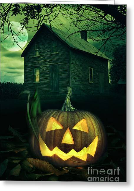 Haunted House Greeting Card Greeting Cards - Halloween pumpkin in front of a Spooky house Greeting Card by Sandra Cunningham