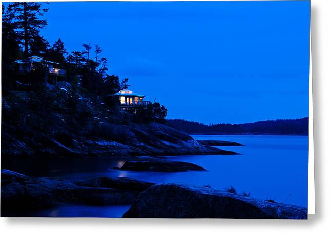 Backlit Greeting Cards - Illuminated cabin in the dark at the seaside Greeting Card by Ulrich Schade